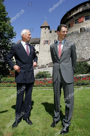 Prince Hans-adam of Liechtenstein Ii (l) and His Son Crown Prince Alois of Liechtenstein Pose After the Ceremony Marking the Handing Over of the State Leadership Vaduz 15 August 2004 Prince Hans-adam Ii Von Und Zu Liechtenstein Handed Over His Powers to His Son Today at a Garden Party For His Subjects -- All 33 000 of Them Liechtenstein Vaduz