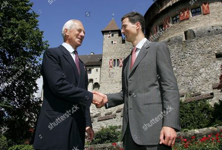 Prince Hans-adam of Liechtenstein Ii (l) and His Son Crown Prince Alois of Liechtenstein Shake Hands at a Ceremony Marking the Handing Over of the State Leadership Vaduz 15 August 2004 Prince Hans-adam Ii Von Und Zu Liechtenstein Handed Over His Powers to His Son Today at a Garden Party For His Subjects -- All 33 000 of Them Liechtenstein Vaduz
