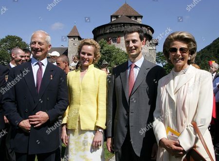 Prince Hans Adam Ii of Liechtenstein His Wife Princess Marie (r) and Crown Prince Alois (2-r) and Crown Princess Sophie Pose For Photos After a Ceremony Marking the Handing Over of the State Leadership Vaduz 15 August 2004 Prince Hans-adam Ii Von Und Zu Liechtenstein Handed Over His Powers to His Son Alois Today at a Garden Party For His Subjects -- All 33 000 of Them Liechtenstein Vaduz