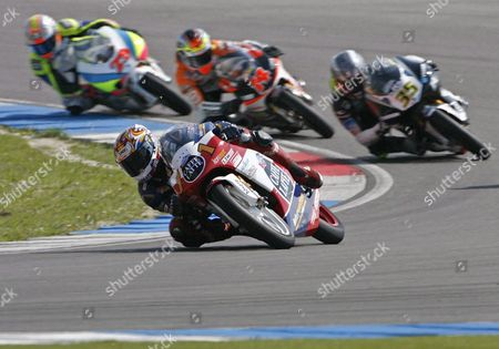 Swiss 125cc Motorcycle Rider Thomas Luethi on Honda (front) Races Ahead of Raffaele De Rosa Italy Gabor Talmacsi Hungary and Andrea Iannone Italy (r-l) During the 125cc Class Dutch Tt Assen Or Grand Prix of Holland in Assen Netherlands Saturday 24 June 2006 Luethi who Started From the 19th Position Finnished in 8th Place De Rosa Finnished in 10th and Talmacsi Finnished in 11th While Iannone Did not Finish the Race Netherlands Assen