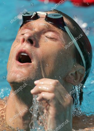 Us Swimmer Lenny Krayzelburg Reacts After His Men's 100m Backstroke Qualifying Heat at the Athens Olympic Aquatic Centre Sunday 15 August 2004 Epa/keystone Patrick B Kraemer Greece Athens