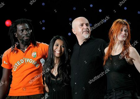 (l to R) Tiken Jah Fakoly of Ivory Coast Anggun of Indonesia Peter Gabriel of Great Britain and Axelle Red of France During a Concert by Youssou N'dour and Friends at the Arena in Geneva Switzerland Late Saturday 8 October 2005 the Musicians Performed at a Un-organized Concert Against Malaria on the Occasion of the 60th Anniversary of the United Nations Switzerland Schweiz Suisse Geneva