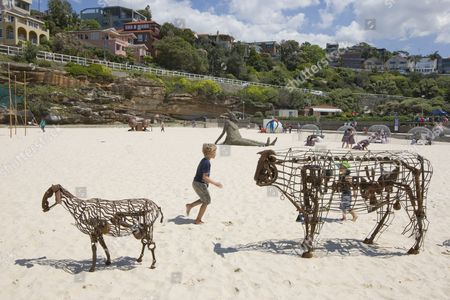 'waiting...' by sculptors Andy Townsend and Suzie Bleach. 'Sculpture By The Sea', 12th annual exhibition  of sculptures on the two kilometre cliff walk between Bondi and Tamarama beaches