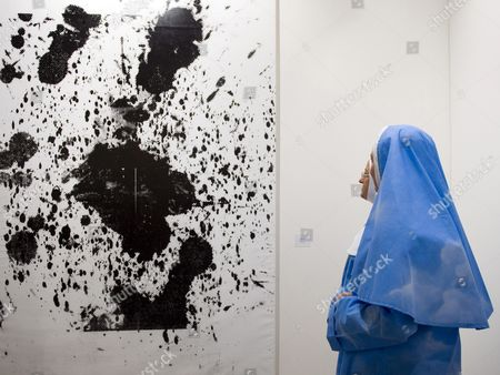 Nuns in Sky-blue Robes Look at an Untitled Artwork in Black and White (2000) by Us Artist Christopher Wool at the International Art Show Art 42 Basel in Basel Switzerland 15 June 2011 Art 42 Basel Features More Than 300 Leading Art Galleries From All Continents Contemporary Art Works by Over 2 500 Artists Will Be on Display From 15 to 19 June Switzerland Schweiz Suisse Basel Bale Basilea Basle