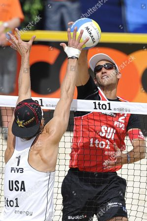 Switzerlands Jan Schnider (r) Smashes Against Usa's Casey Jennings (l) During the Beachvolley Worldtour 10 July 2009 in Gstaad Switzerland Switzerland Schweiz Suisse Gstaad