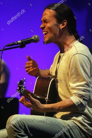 Stock Image of Us Singer Justin Nozuka Performs at Blue Balls Festival in Lucerne Switzerland 30 July 2011 Switzerland Schweiz Suisse Luzern