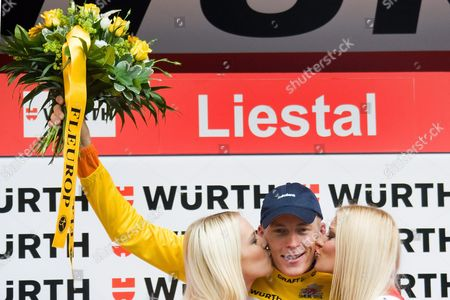 Netherland's Robert Gesink From Team Rabobank the Overall Leader is Kissed on the Podium by Former Miss Switzerland Christa Rigozzi (r) and Miss Switzerland Linda Faeh (l) After the 8th Stage a 204 1 Km Race From Wetzikon to Liestal at the 74th Tour De Suisse Uci Protour Cycling Race in Liestal Switzerland 19 June 2010 Switzerland Schweiz Suisse Liestal