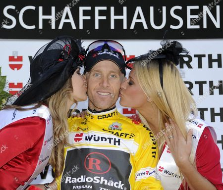 Us's Levi Leipheimer of Team Radioshack the Winner is Kissed by Former Miss Switzerland Christa Rigozzi Right and Miss Switzerland Kerstin Cook Left on the Podium After a 32 1 Km Race Against the Clock During the 9th and Final Stage From Schaffhausen to Schaffhausen at the 75th Tour De Suisse Uci Protour Cycling Race in Schaffhausen Switzerland Sunday June 19 2011 Switzerland Schweiz Suisse Schaffhausen