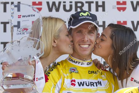 The Overall Winner Rui Alberto Faia Da Costa of Portugal of Team Movistar is Kissed by Christa Rigozzi Miss Switzerland 2006 Left and Alina Buchschacher Miss Switzerland 2011 on the Podium After the 9th Stage a 216 Km Race From Naefels-lintharena to Soerenberg at the 76th Tour De Suisse Cycling Race Switzerland Sunday June 17 2012 Switzerland Schweiz Suisse Soerenberg