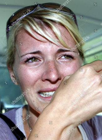 Stock Image of Chiara Evans Wife of Cadel Evans of Australia Shares Some Tears of Joy After Her Husband Won the Men's Road Race at the Uci Road World Championships in Mendrisio Switzerland Sunday 27 September 2009 Switzerland Schweiz Suisse Mendrisio