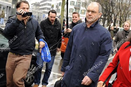 Rudolf Elmer (r) Whistle-blower and Former Top-banker at the Bank Julius Baer is Accompanied by Reporters As He Leaves the Zurich District Court to Face Charges of Breaking Swiss Banking Secrecy Laws on 19 January 2011 on 17 January 2011 Elmer Handed Over Two Cds to Wikileaks Founder Julian Assange in Front of the World's Media Switzerland Schweiz Suisse Zurich
