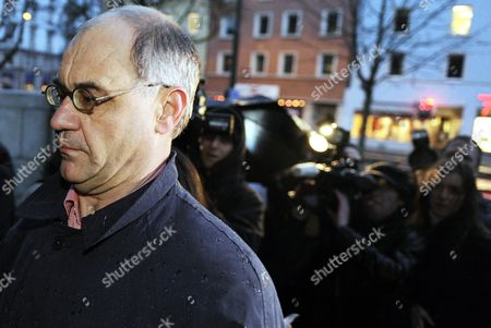 Stock Image of Rudolf Elmer Whistle-blower and Former Top Swiss Banker at the Bank Julius Baer Passes Tv Cameras on His Arrival at the Zurich District Court to Face Charges of Breaking Swiss Banking Secrecy Laws January 19 2011 on January 17 2011 Elmer Handed Over Two Cd-roms to Wikileaks Founder Julian Assange at a Press Conference in London Saying That the Data Stemmed From at Least Three Financial Institutions and Covered a Period From 1990 to 2009 Switzerland Schweiz Suisse Zurich