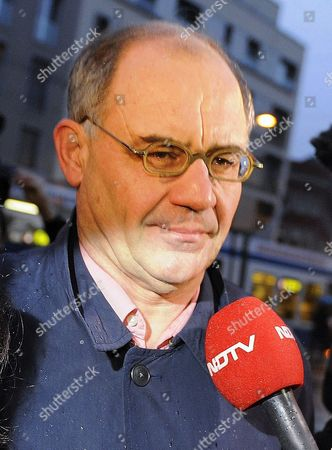 Close Up of Rudolf Elmer Whistle-blower and Former Top Banker at the Bank Julius Baer As He is Approached by a Tv Reporter on His Arrival at the Zurich District Court to Face Charges of Breaking Swiss Banking Secrecy Laws January 19 2011 on January 17 2011 Elmer Handed Over Two Cd-roms to Wikileaks Founder Julian Assange at a Press Conference in London Saying That the Data Stemmed From at Least Three Financial Institutions and Covered a Period From 1990 to 2009 Switzerland Schweiz Suisse Zurich