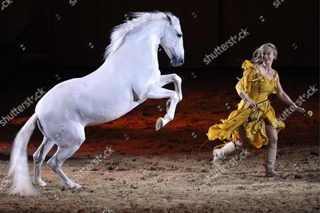 Stock Photo of Sylvie Willms (r) Performs During the Equestrian Show Entitled 'Apassionata Zauber Der Freiheit' (apassionata Charm of Freedom) in Basel Switzerland 27 March 2010 More Than 40 Horses and Europe's Most Accomplished Riders Take Part in This Horse Gala Switzerland Schweiz Suisse Basel