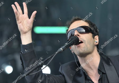 Stock Image of Belgian Singer John Stargasm of 'Ghinzu' Performs on the Main Stage During the 34th Paleo Festival in Nyon Switzerland 22 July 2009 the Paleo Open-air Music Festival the Largest in Switzerland Runs From 21 to 26 July Switzerland Schweiz Suisse Nyon