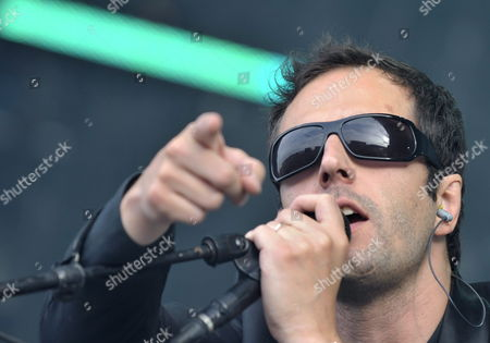 Stock Photo of Belgian Singer John Stargasm of 'Ghinzu' Performs on the Main Stage During the 34th Paleo Festival in Nyon Switzerland 22 July 2009 the Paleo Open-air Music Festival the Largest in Switzerland Runs From 21 to 26 July Switzerland Schweiz Suisse Nyon