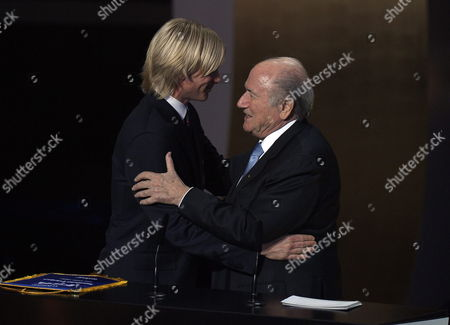 Stock Picture of Fifa President Joseph Blatter (r) Honours Italian Soccer Player Simone Farina (l) During the Fifa Ballon D'or 2011 Gala Held at the Kongresshaus in Zurich Switzerland 09 January 2012 Farina Become Famous During the 2011 Italian Football Scandal when He was Approached and Offered 200 000 Euros by Alessandro Zamperini a Former Teammate in a S Roma to Influence the Outcome of an Italian Cup Match Between Cesena and Gubbio on November 30 2011 the Player Refused and Reported the Incident to the Police Switzerland Schweiz Suisse Zurich