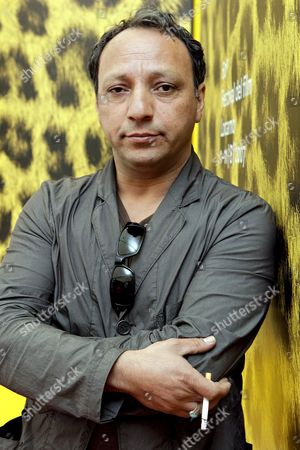 Morocco Born Film Director Hiner Saleem Poses During a Photocall Prior to the Presentation of His Film 'Sous Les Toits De Paris' (beneath the Roofs of Paris) at the 60th International Film Festival Locarno 09 August 2007 in Locarno Switzerland Switzerland Schweiz Suisse Locarno
