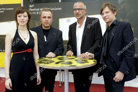 Stock Image of Austrian Film Director Peter Payer (2-r) Poses Together with German Actress Lavinia Wilson (l) German Actor Frank Giering (2-l) and Austrian Actor Robert Stadlober (r) During a Photocall Prior to the Presentation of Their Movie 'Freigesprochen' (free to Leave) at the 60th International Film Festival Locarno 06 August 2007 in Locarno Switzerland Switzerland Schweiz Suisse Locarno