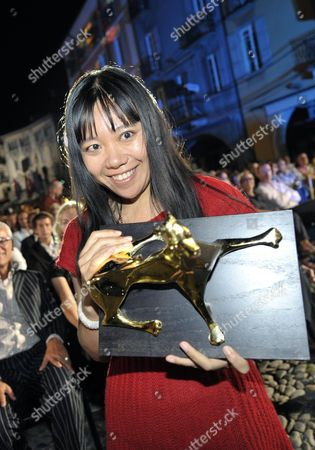 Chinese Director Xiaolu Guo Poses with the Golden Leopard the Top-ranking Award of the International Competition She Received For Her Movie 'She a Chinese' After the Award Ceremony on Piazza Grande at the 62nd Locarno International Film Festival Saturday August 15 2009 in Locarno Switzerland Switzerland Schweiz Suisse Locarno