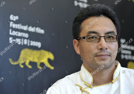 Chinese (tibetan) Director Pema Tseden Poses During a Photocall Prior to the Presentation of His Movie 'The Search' at the 62nd Locarno International Film Festival 11 August 2009 in Locarno Switzerland the Festival Runs Until 15 August Switzerland Schweiz Suisse Locarno