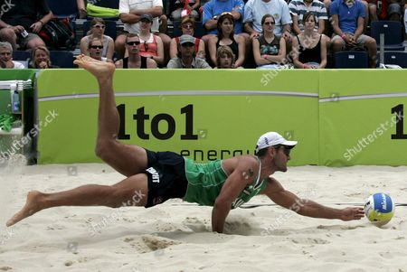 Australia's Andrew Schacht Jumps to Get a Ball During the Round of 16 Match Between Germany's Eric Koreng and David Klemperer Against Australia's Andrew Schacht and Josh Slack at the Fivb Beachvolleyball World Championships in Gstaad Switzerland on Saturday 28 2007 Switzerland Schweiz Suisse Gstaad