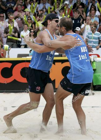Australia's Andrew Schacht (r) and Josh Slack (l) Celebrate Their Victory After the Match For the Bronze Medal Between Brazil's Ricardo Santos and Emanuel Rego Against Australia's Andrew Schacht and Josh Slack at the Fivb Beachvolleyball World Championships in Gstaad Switzerland on 29 July 2007 Switzerland Schweiz Suisse Gstaad