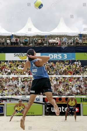 Australia's Josh Slack Serves During the Match For the Bronze Medal Between Brazil's Ricardo Santos and Emanuel Rego Against Australia's Andrew Schacht and Josh Slack at the Fivb Beachvolleyball World Championships in Gstaad Switzerland on 29 July 2007 Switzerland Schweiz Suisse Gstaad