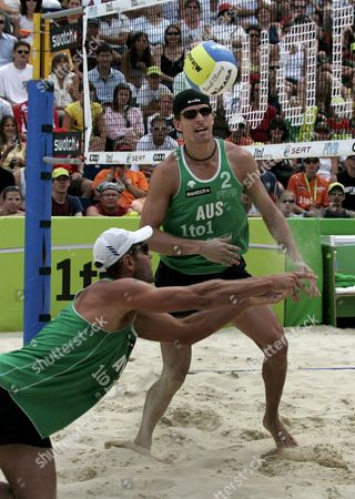 Australia's Andrew Schacht Left Passes a Ball to Josh Slack Right During the Round of 16 Match Between Germany's Eric Koreng and David Klemperer Against Australia's Andrew Schacht and Josh Slack at the Fivb Beachvolleyball World Championships in Gstaad Switzerland on Saturday 28 2007 Switzerland Schweiz Suisse Gstaad