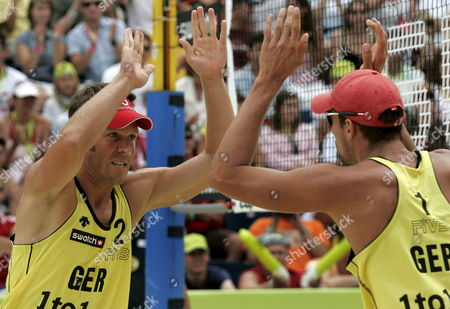 Germany's Eric Koreng Right and David Klemperer Left Cheer After Winning a Point During the Round of 16 Match Between Germany's Eric Koreng and David Klemperer Against Australia's Andrew Schacht and Josh Slack at the Fivb Beachvolleyball World Championships in Gstaad Switzerland on Saturday 28 2007 Switzerland Schweiz Suisse Gstaad