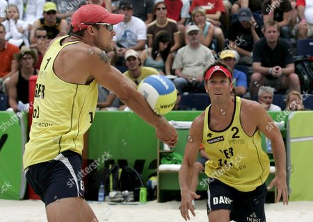 Germany's Eric Koreng Left and David Klemperer Right Receive a Serve During the Round of 16 Match Between Germany's Eric Koreng and David Klemperer Against Australia's Andrew Schacht and Josh Slack at the Fivb Beachvolleyball World Championships in Gstaad Switzerland on Saturday 28 2007 Switzerland Schweiz Suisse Gstaad