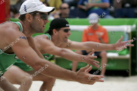Australia's Andrew Schacht Front and Josh Slack Back Expect a Serve During the Round of 16 Match Between Germany's Eric Koreng and David Klemperer Against Australia's Andrew Schacht and Josh Slack at the Fivb Beachvolleyball World Championships in Gstaad Switzerland on Saturday 28 2007 Switzerland Schweiz Suisse Gstaad