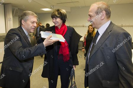 Swiss Federal President Micheline Calmy-rey (c) and Yossi Beilin (l) Chief of Israeli Delegation For Geneva Initiative Lift the Roadmap of the Geneva Initiative in Front of Yasser Abed Rabbo (r) Former Palestinian Minister and Chief of Palestinian Delegation of Geneva Initiative Prior a Meeting About the Geneva Initiative in Geneva Switzerland 22 November 2011 the Geneva Initiative was Drafted Jointly by Israelis and Palestinians From Civil Society with the Aim of Resolving the Conflict Between the Two Peoples Peacefully and on the Basis of Fair Negotiations Switzerland Schweiz Suisse Geneva