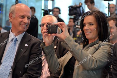German Former Skier and Cinematographer Willy Bogner (l) Managing Director of the Munich 2018 Bid Committee Watches Former Figure Skater Katarina Witt Chairwoman of the Munich 2018 Bid Committee (r) Taking Some Snapshots at the Ioc Headquarters in Lausanne Switzerland on 22 June 2010 Before Learning That Munich Moves to the Next Level of Competition to Host 2018 Olympic Winter Games Switzerland Schweiz Suisse Lausanne