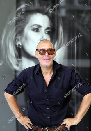 Swiss Photographer Michel Comte Poses For Photographs in Front of a Portrait of Catherine Deneuve on Display During a Photo Exhibition Held at the Museum of Design in Zurich Switzerland 28 August 2009 Michel Comte is Known For His Contribution in Fashion and Advertising the Michel Comte Photo Exhibition Runs From 30 August 2009 to 03 January 2010 Switzerland Schweiz Suisse Zurich