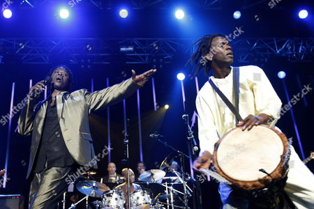 Senegalese Singer Baaba Maal Left and Musician Massamba Diop Right Perfom on the Stravinski Hall Stage at the 43rd Montreux Jazz Festival in Montreux Switzerland 10 July 2009 Switzerland Schweiz Suisse Montreux