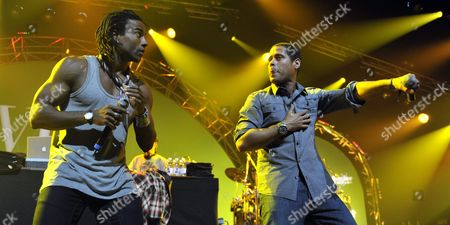 Members of Cuban Hip Hop Band 'Orishas' Singers Yotuel Romero (l) and Hiram Riveri (r) Perform on Stage at the Avo Session in Basel Switzerland 30 October 2009 Switzerland Schweiz Suisse Basel