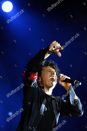 Frontman Nicola Sirkis of French Group Indochine Performs on the Main Stage During the Last Day of the Paleo Festival in Nyon Switzerland Late Sunday 23 July 2006 Switzerland Schweiz Suisse Nyon