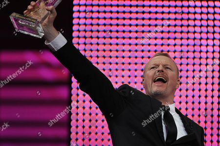 German Entertainer Stefan Raab Reacts After Receiving the Rose D'or Award For the Best Production in the Category 'Live Event Show' For the 'Eurovision Song Contest 2011' Produced by German Tv Channel Ard During the Award Ceremony of the 51st Festival Rose D'or Or Golden Rose Global Entertainment Television Festival at the Culture and Congress Center (kkl) in Lucerne Switzerland 10 May 2012 Switzerland Schweiz Suisse Lucerne