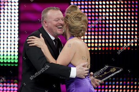 German Entertainer Stefan Raab (l) Hugs German Host Barbara Schoeneberger After Receiving an Award During the Award Ceremony of the 51st Festival Rose D'or Or Golden Rose Global Entertainment Television Festival at the Culture and Congress Center (kkl) in Lucerne Switzerland 10 May 2012 Switzerland Schweiz Suisse Lucerne