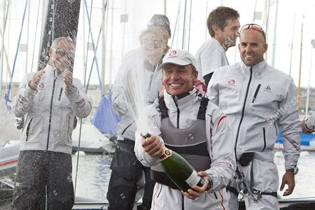 Swiss Skipper Ernesto Bertarelli (front) of Team Alinghi Celebrates His Victory of the 'Bol D' Or' Sailing Race on the Geneva Lake in Geneva Switzerland 18 June 2011 About 500 Boats Participated in the Bol D'or the Societe Nautique De Geneve (sng) Organized One of the Worlds Biggest Regattas and the Largest Sailing Event Held on a Lake in Europe Switzerland Schweiz Suisse Geneva