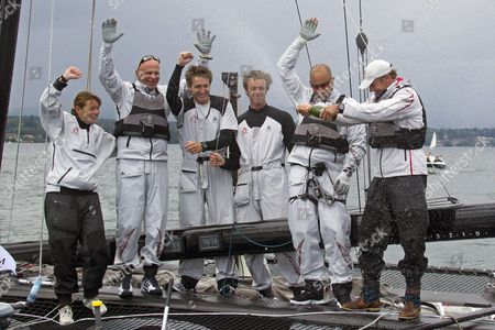 Swiss Skipper Ernesto Bertarelli (r) of Team Alinghi and His Crew Celebrate Their Victory in the 'Bol D' Or' Sailing Race on the Geneva Lake in Geneva Switzerland 18 June 2011 About 500 Boats Participated in the Bol D'or the Societe Nautique De Geneve (sng) Organized One of the Worlds Biggest Regattas and the Largest Sailing Event Held on a Lake in Europe Switzerland Schweiz Suisse Geneva