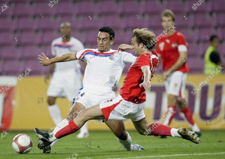 Costa Rica's Azofeifa Randall (l) Fights For the Ball with Austria's Ferdinand Felhofer (r) During a Friendly Football Match Between the National Soccer Teams of Austria and Costa Rica in Geneva Stadium Switzerland Saturday September 2 2006 Austria Costa Rica Switzerland and Venezuela Are Participating in the Four Countries Tournament Taking Place in Basel and Geneva Switzerland Schweiz Suisse Geneva