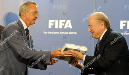 Stock Picture of Johann Cruyff (l) Ambassador For the Holland Belgium Bid Hands Over the Country's Joint Bid to Host the Fifa Soccer World Cup 2018/2022 to Fifa President Josef S Blatter (r) in Zurich Switzerland 14 May 2010 Switzerland Schweiz Suisse Zurich