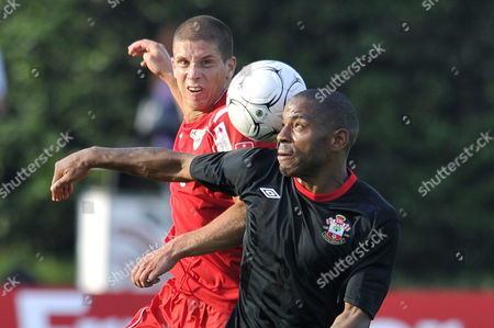 Fc Thun's Benjamin Luethi (l) Fights For the Ball Against Southampton Fc's Alex Chamberlain (r) During the Soccer Friendly Game Between Fc Thun and Southampton Fc in the Lachen Stadium in Thun Switzerland 13 July 2010 Switzerland Schweiz Suisse Thun