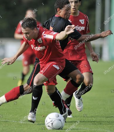 Switzerland's Andreas Wittwer Left Fights For the Ball Against England's Alex Chamberlain During the Soccer Friendly Game Between Fc Thun and Southampton Fc in the Lachen Stadium in Thun Switzerland Tuesday July 13 2010 Switzerland Schweiz Suisse Thun