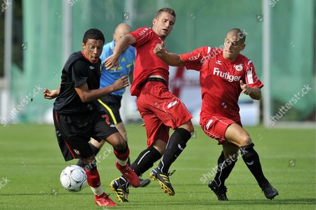 Switzerland's Muhamed Demiri Center and Dennis Hediger Right Fights For the Ball Against England's Alex Chamberlain During the Soccer Friendly Game Between Fc Thun and Southampton Fc in the Lachen Stadium in Thun Switzerland Tuesday July 13 2010 Switzerland Schweiz Suisse Thun