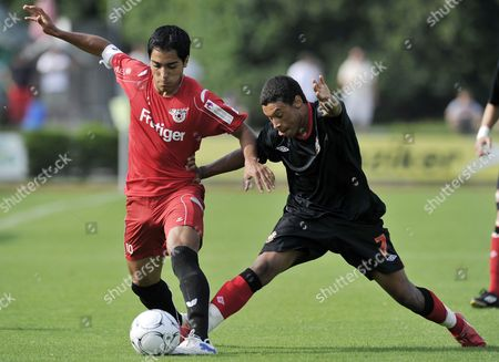 Switzerland's Oscar Sacarione Left Fights For the Ball Against England's Alex Chamberlain During the Soccer Friendly Game Between Fc Thun and Southampton Fc in the Lachen Stadium in Thun Switzerland Tuesday July 13 2010 Switzerland Schweiz Suisse Thun