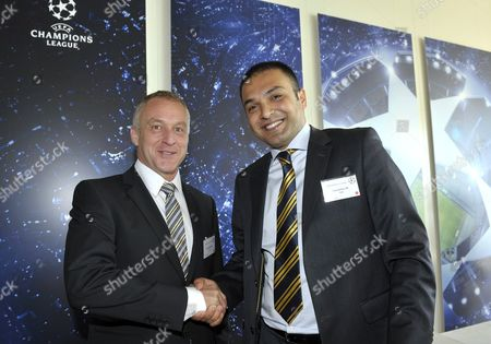 Stock Picture of Hasan Cetinkaya (r) Team Manager of Turkish Soccer Club Fenerbahce Sk Shakes Hands with Stefan Niedermaier (l) Ceo of Swiss Soccer Club Bsc Young Boys After the Draw For the Europa League 2010/11 Third Qualifying Round at the Uefa Headquarters in Nyon Switzerland 16 July 2010 Switzerland Schweiz Suisse Nyon