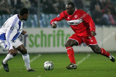 Grasshoppers' Kim Jaggy (l) and Fc Middlesbrough's Jimmy Hasselbaink Fight For the Ball During Their Uefa Cup Group D Match in Zurich Switzerland Thursday October 20 2005 Switzerland Schweiz Suisse Zurich